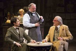 Robbie Tann as Einstein, Tom Rhy Farrell as the cafe owner Freddie and Ronald Guttman as the art dealer, Sagot.  Photo by T. Charles Erickson.