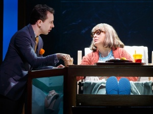 Jack (Rob McClure) promises his mother (Nancy Opel) on her death-bed to never marry.  Photo by Joan Marcus