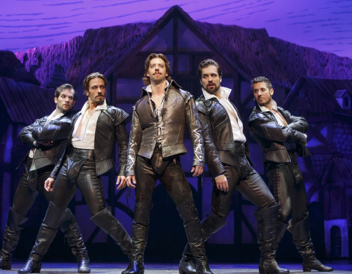 Christian Borle as Shakespeare with his groupies.  Photo by Joan Marcus