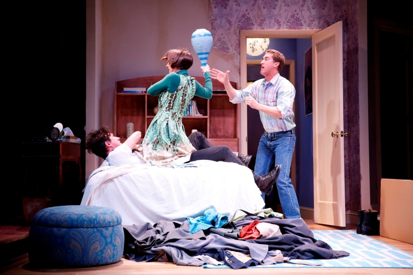 Susannah is attacking Trevor while Malcolm tries to protect the vase. Photo by Carol Rosegg
