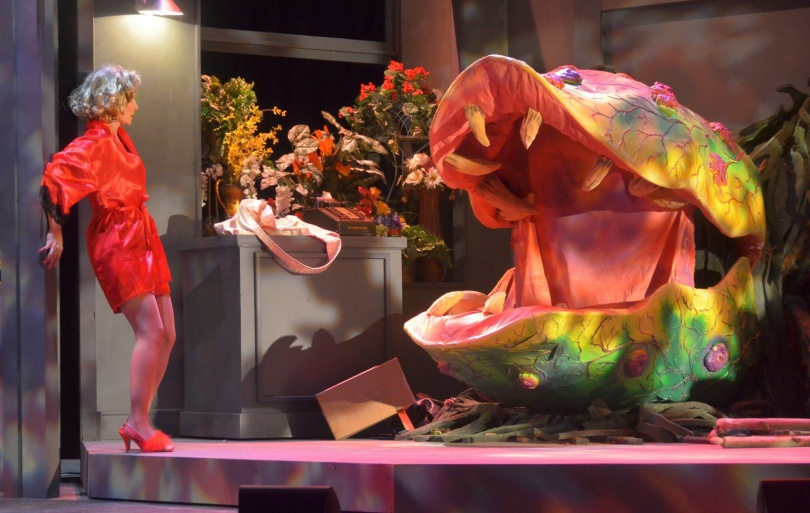 Laura Woyasz as Audrey with Audrey II created by Austin Costello. Photo by George U. Willimas